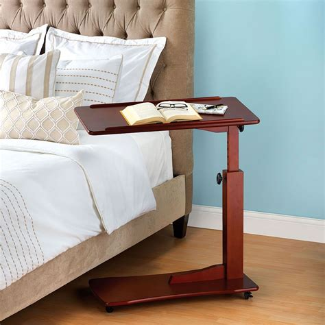adjustable height side table the adjustable height side table hammacher schlemmer