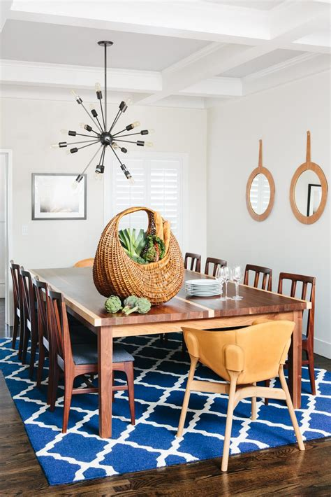 bright dining room  blue patterned rug large dining