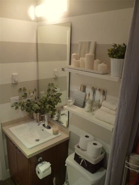 Decorating Ideas For Small Bathrooms In Apartments by A Basket Is A Great Way To Store Extra Toilet Paper In A