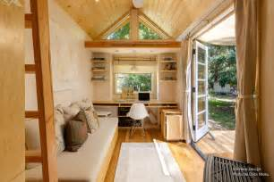 woman living simply off grid tiny home wheels the front door back trailer soffit still isna