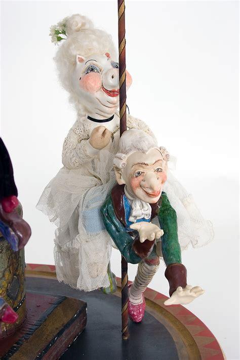 porcelain doll on carousel carousel 1 k porcelain wax one of a doll