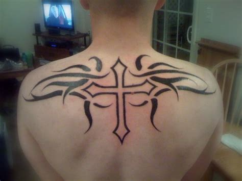 upper back tribal tattoo tribal and cross on back tattooshunt