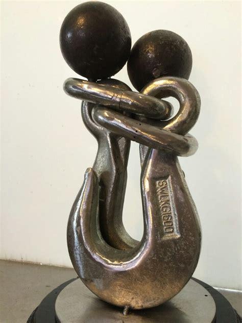 Handmade Sculptures - metal handmade sculpture forever together from iron hooks