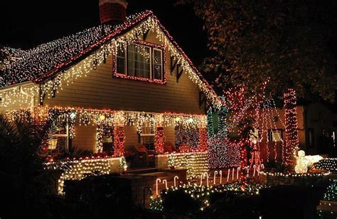 love the icicle lights on the eaves a christmas house