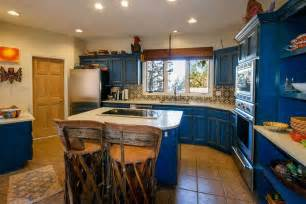 blue kitchen island design with wooden chairs for mexican