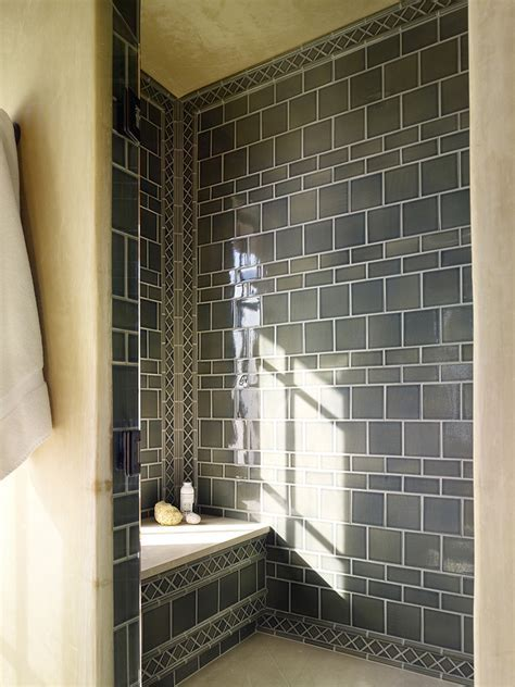 shower tile patterns Bathroom Mediterranean with dark tile