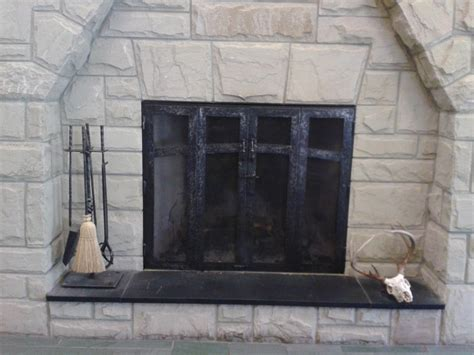 crafted custom fireplace screen and fireplace tools
