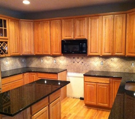 light colored oak cabinets with granite countertop