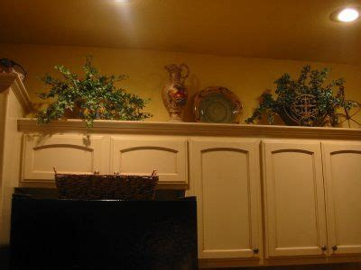 how to decorate top of kitchen cabinets pinterest ideas on how to decorate above your kitchen cabinets for