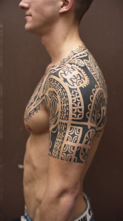 tribal chest and half sleeve tattoo grey ink chest and half sleeve for