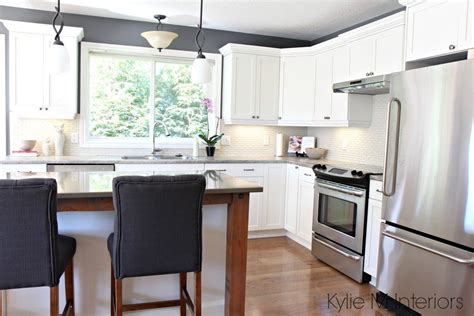 Maple kitchen cabinets painted Cloud White in a makeover