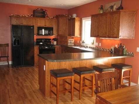 my kitchen with mission style oak cupboards and terra cotta orange walls wall color ideas