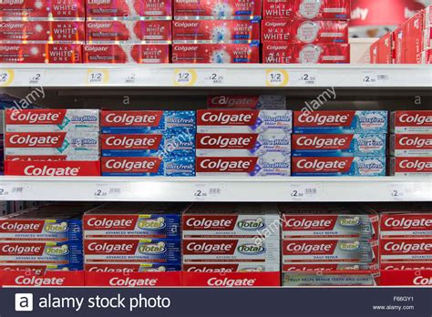 colgate toothpaste for sale on a shelf in a supermarket
