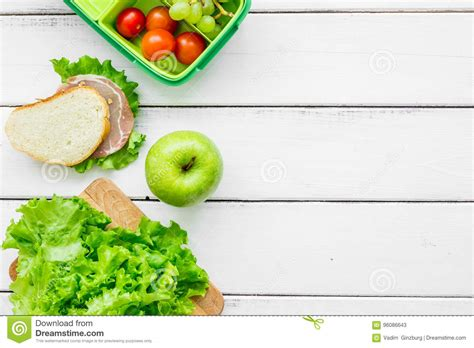 take away with lunchbox and fresh food on white background