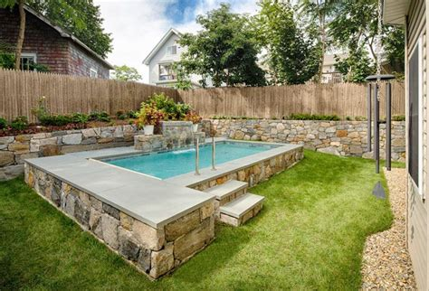small outdoor pools step it up stone wall surrounds plunge pools