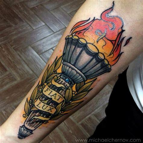 black torch tattoo thieving genius done by michael chernov michael