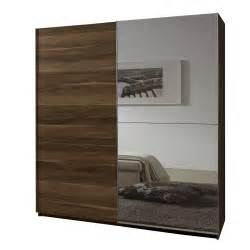 Mirrored sliding door wardrobe with shelving unit and modern sofas