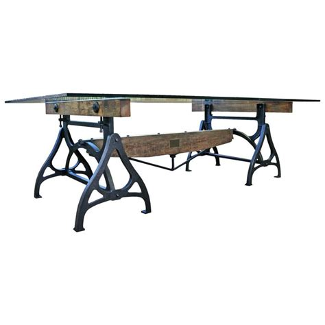 industrial glass dining table conference dining table vintage industrial wood steel cast iron and glass for sale at 1stdibs