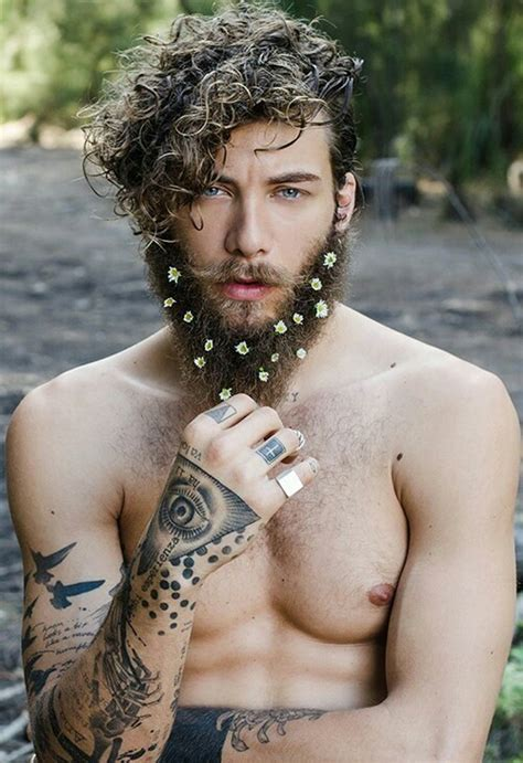 in pics men with flowers in their beards stuff co nz men wearing flowers in their beards growing new trend