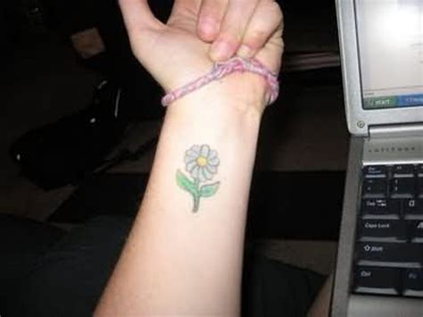 daisy tattoo on wrist 23 flowers wrist tattoos