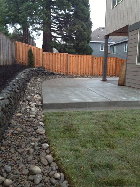 Patio Drainage Ideas by Concrete Patio River Rock Border With Drainage And Lawn