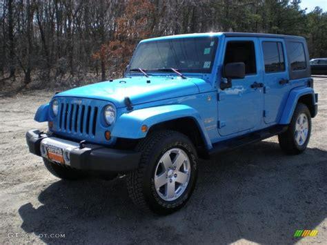 surfboard jeep 2010 surf blue pearl jeep wrangler unlimited sahara 4x4