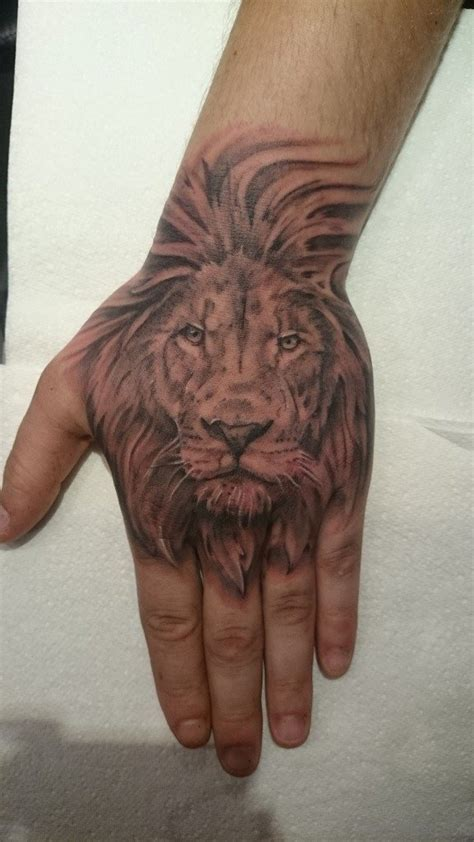 lion tattoo on hand 41 best tattoos on