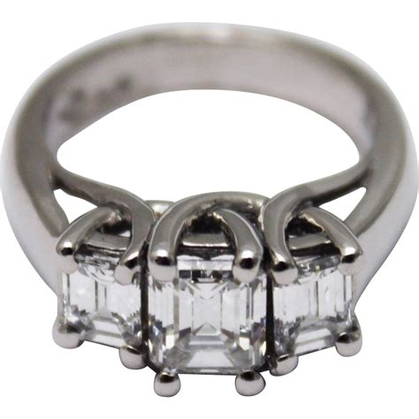 Ruby 2 62 Ct 2 18 ct 3 stones emerald cut ring 14kt white gold