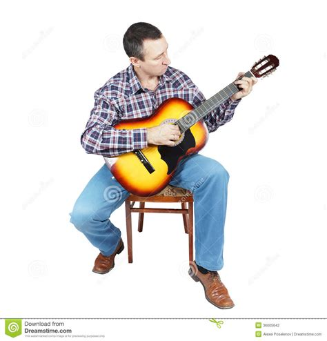 who is the guy that plays guitar and sings on the new direct tv commercials adult man plays a guitar sitting on an chair stock photo