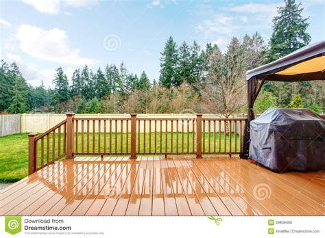 backyard fences and decks backyard with wet deck grill and fence stock photo