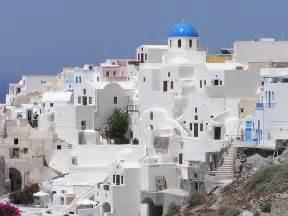 fingertips speaking oia greece houses on hill