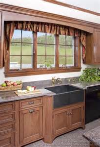 ordinary Window Curtain Designs Photo Gallery #5: kitchen-cabinets-traditional-medium-wood-brown-054-cp029c-country-apron-sink-window-valence.jpg