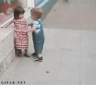 little girl pushes little boy away animated gif funny