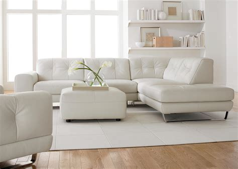 Design Ideas For White Tufted Sofa Chic Floating Shelves With White Tufted Sectional And Square Ottoman On White Rugs As Modern