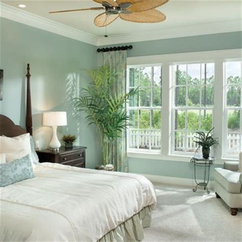 tropical bedroom decorating ideas sw silvermist the wood against the paint color curtains and bedding decor