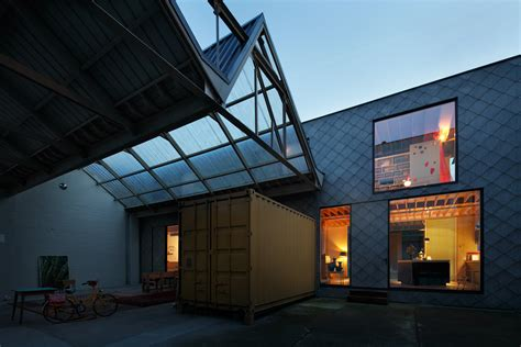belgian warehouse gets an unconventional makeover using
