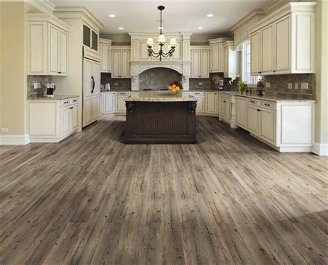 now this is a kitchen with grey wood flooring for the