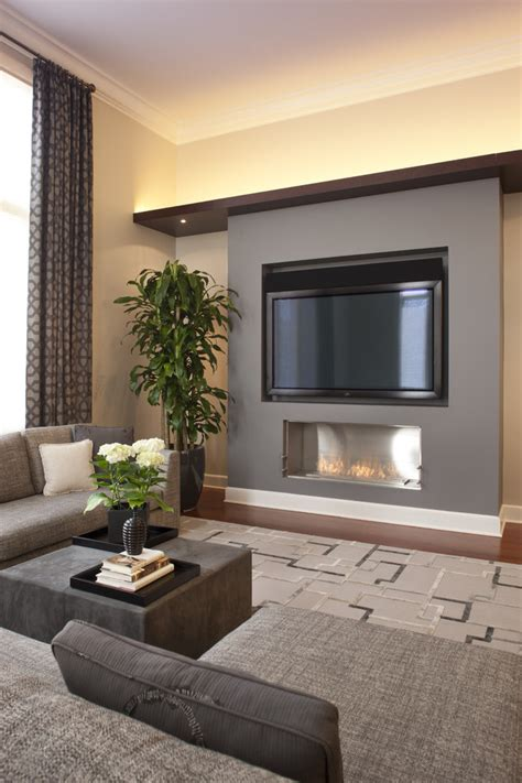 modern fireplace with tv above family room