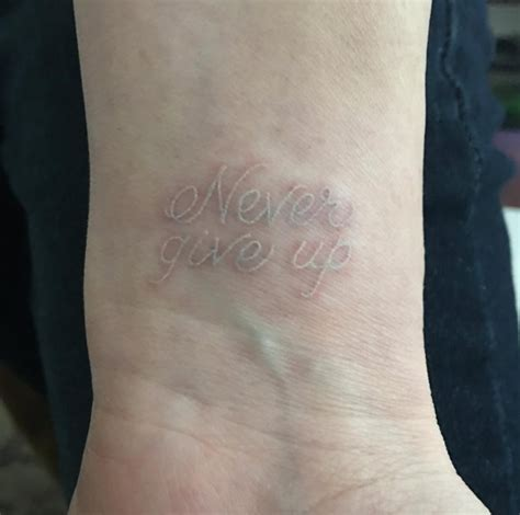 never give up tattoo on wrist 50 amazing wrist tattoos for men women tattooblend