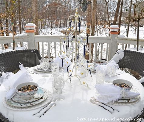 whimsical winter table setting with a nature and snow theme