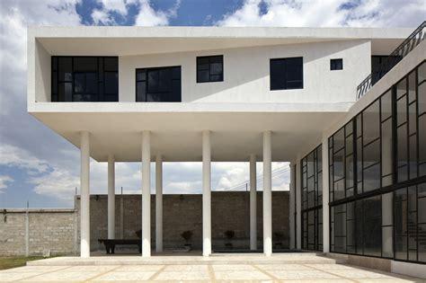 Hacienda Home Interiors modern hacienda style home built on pillars modern house