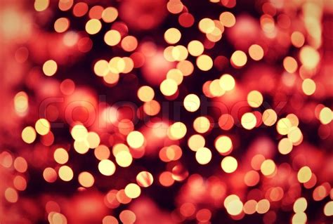 red golden christmas lights background with bokeh stock