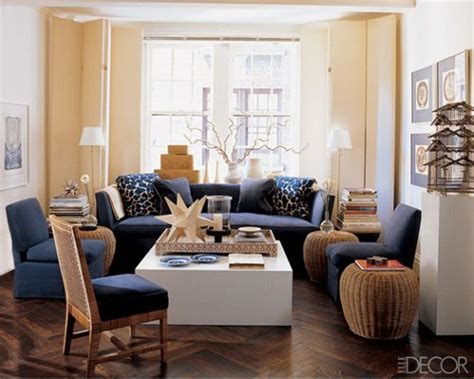 designs for living rooms in navy and beige the walls are beige and the navy comes in through the upholstery warm wood tones can be found
