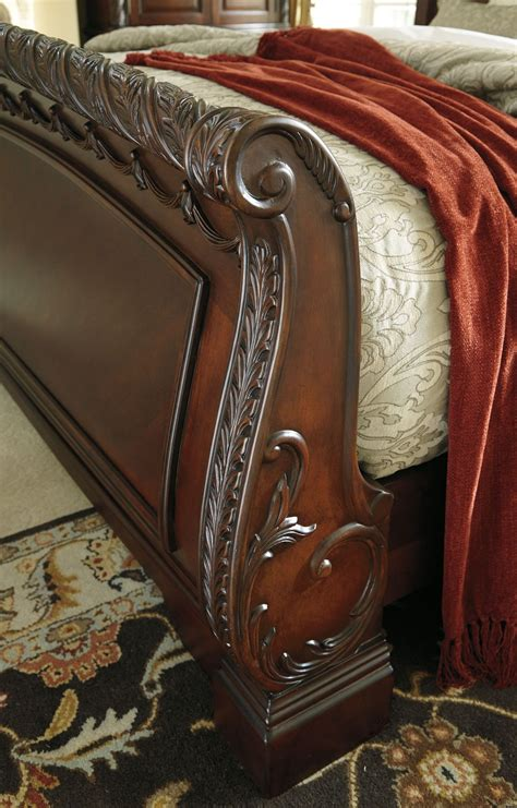 north shore sleigh bedroom set ashley furniture b553 north shore queen sleigh bed from ashley b553 77 74 75