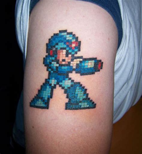 megaman tattoo keep it retro with these awesome 8 bit tattoos brothers