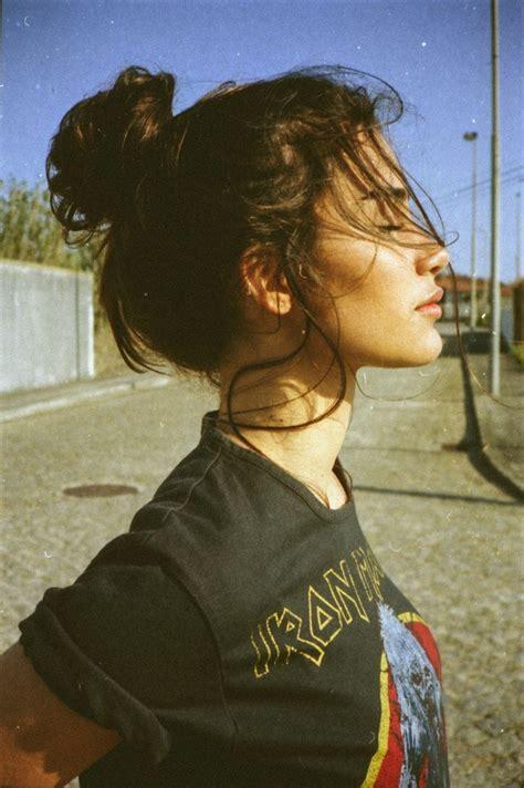 hipster topknot model with a top knot bun wearing an iron maiden t shirt