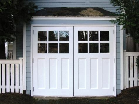 swing carriage garage doors hand made custom wood garage doors and real carriage house