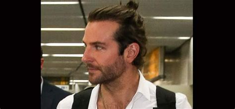 mens mun hairdo mens hairstyle in focus the man bun