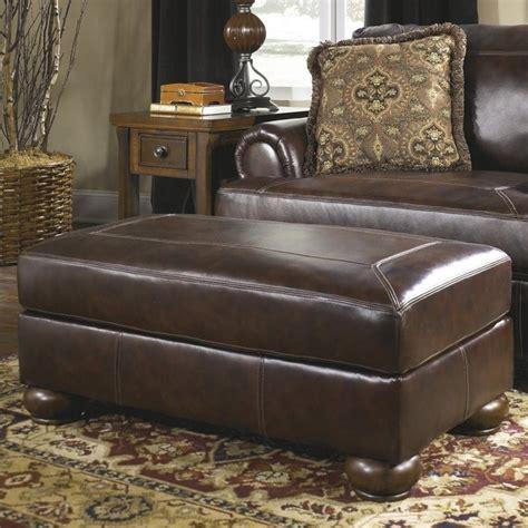 ashley leather ottoman ashley furniture axiom leather ottoman in walnut 4200014