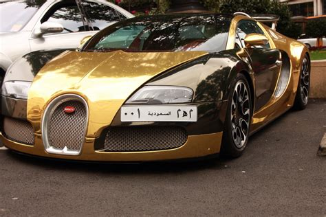 gold and white bugatti gold bugatti veyron mike murray flickr